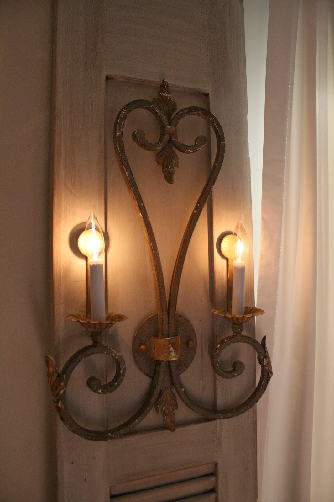 Awesome Wall Sconces on Old Shutter Doors
