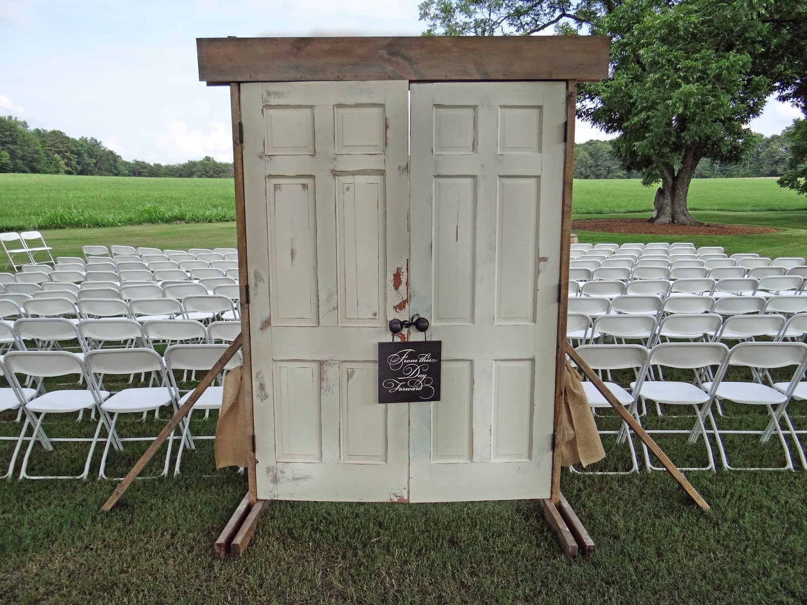 Rustic Vintage Doors Opened To A View Of The Meadow And Pecan Trees Mark Beginning Aisle Which Was Lined With Pails