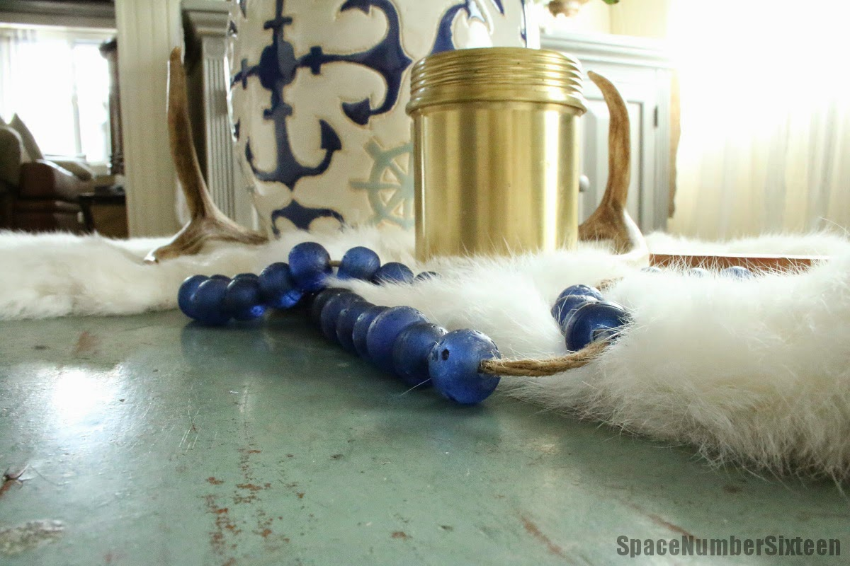 anthropologie brass candle and sea glass beads