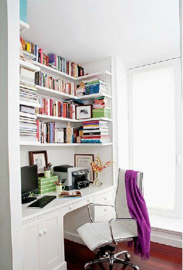 built in desk in a home office with the shelves covered in books