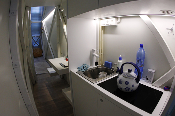 Picture of small kitchen at night in the world's narrowest house