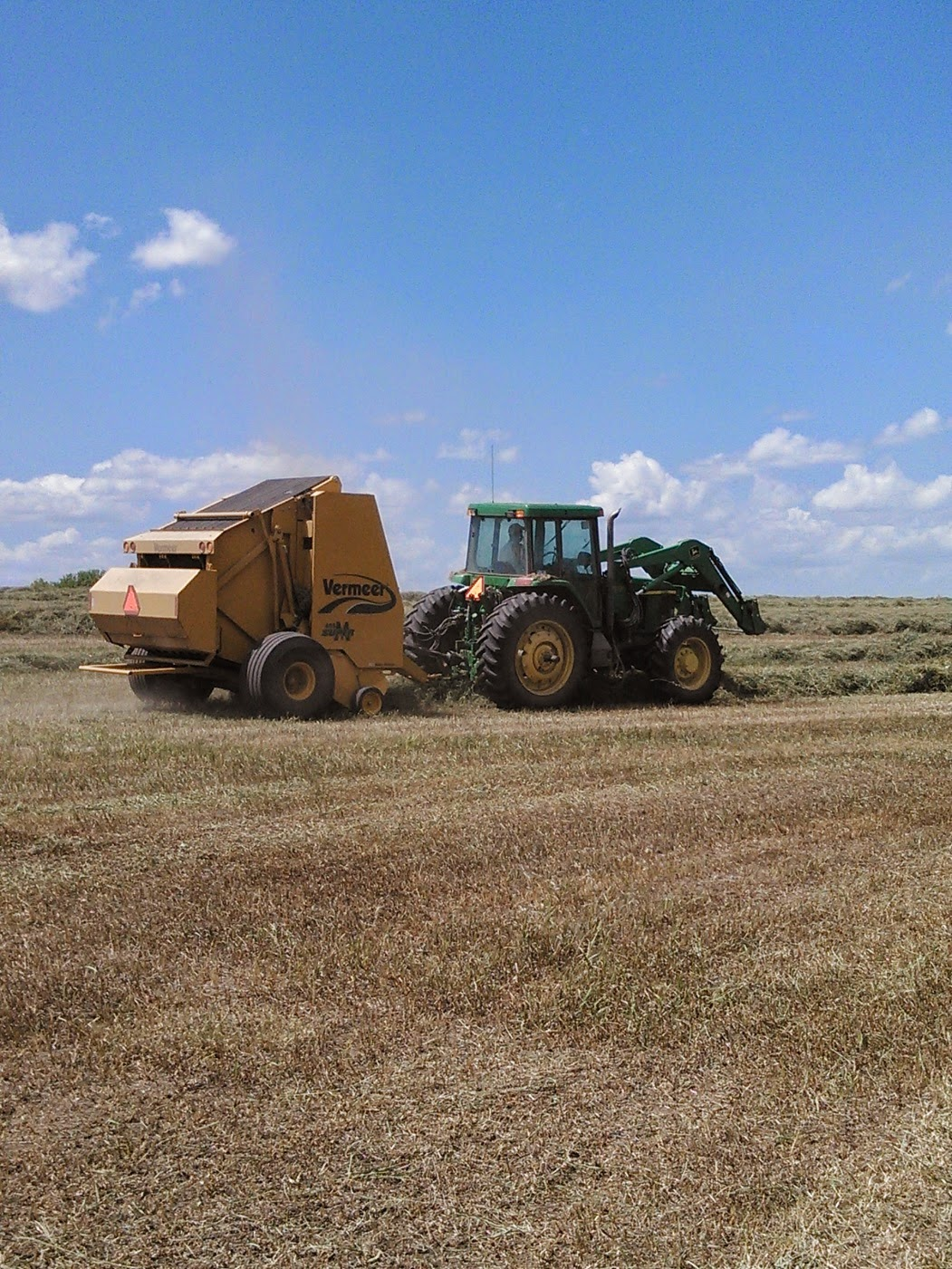 Baling grass hay to be fed to cattle during winter months