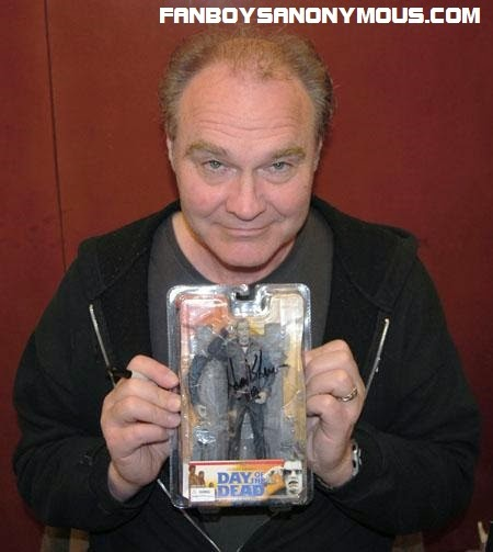 Sherman Howard who played Bub in Day of the Dead holding an action figure of his own character