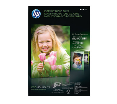Black cardboard box with photo of blond preschool girl holding tulips.