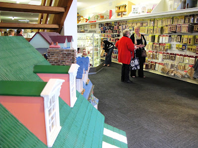 Two customers chatting in the new Fairy Meadow Miniatures shop.