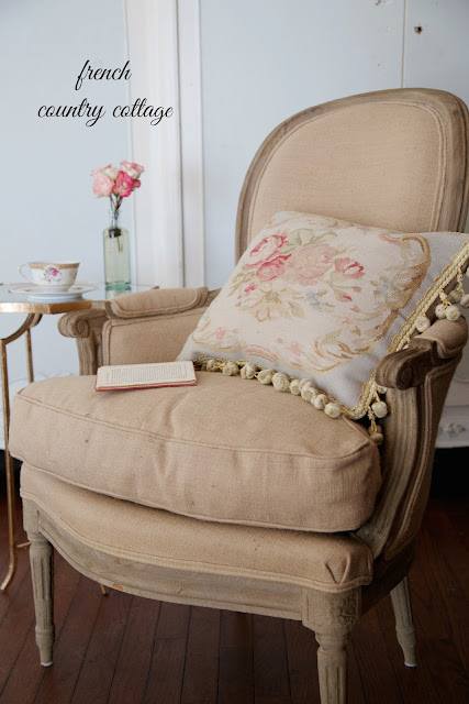 Burlap covered French style chair with aubusson pillow