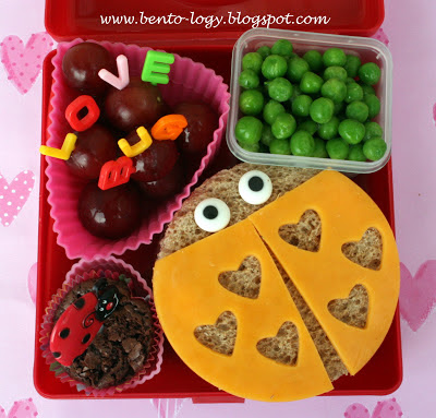 Love Bug sandwich made using the Pampered Chef sandwich cutter and decorated with cheddar cheese and icing eyes