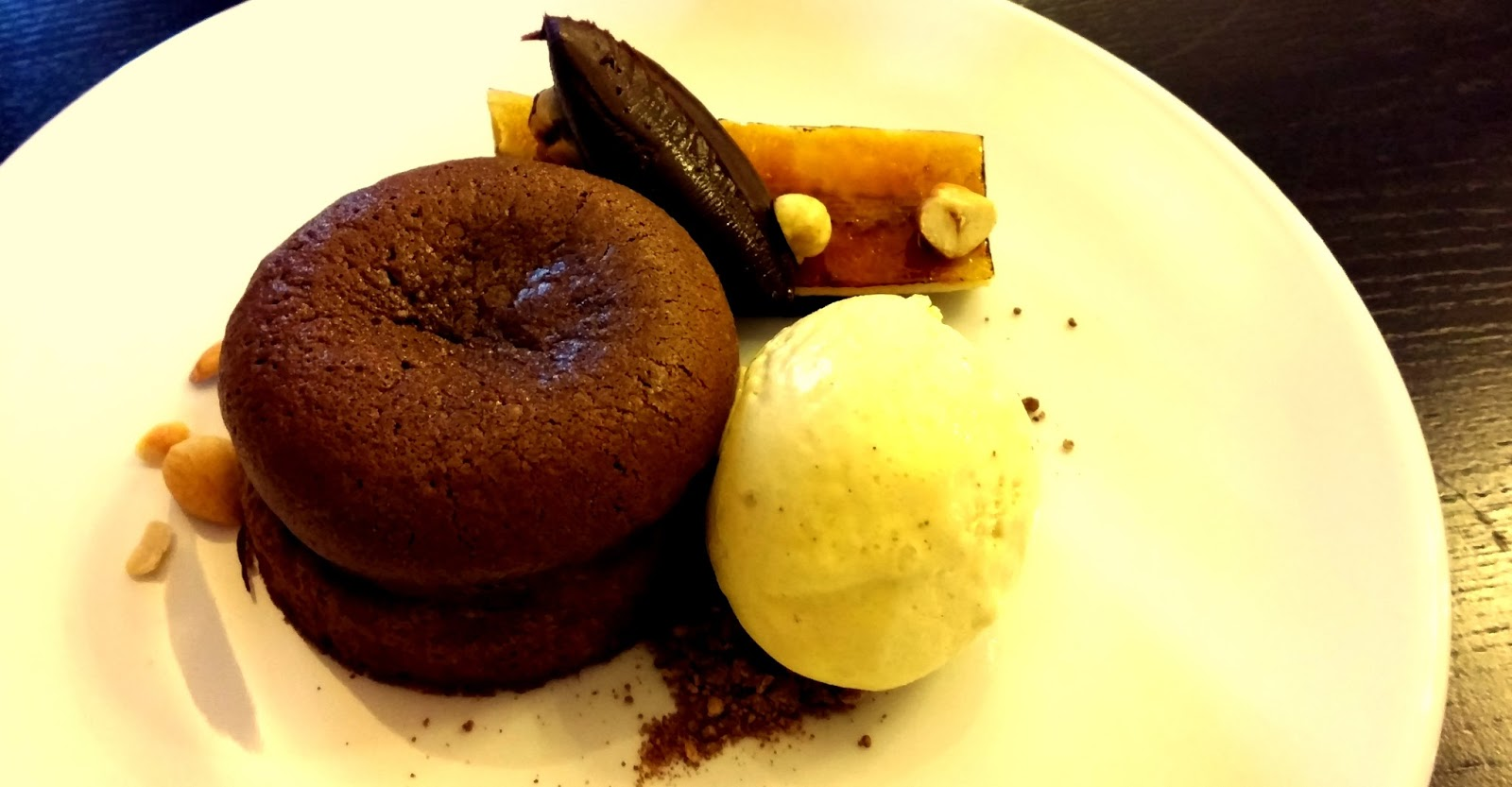 chocolate fondant with glazed banana and roasted hazelnuts at oak tree restaurant bluestone wales