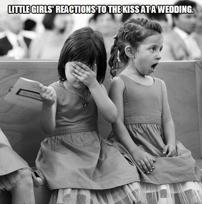 Little Girls' reaction to a kiss at a wedding.