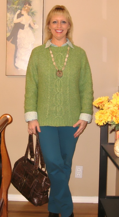 green sweater with turquoise jeans
