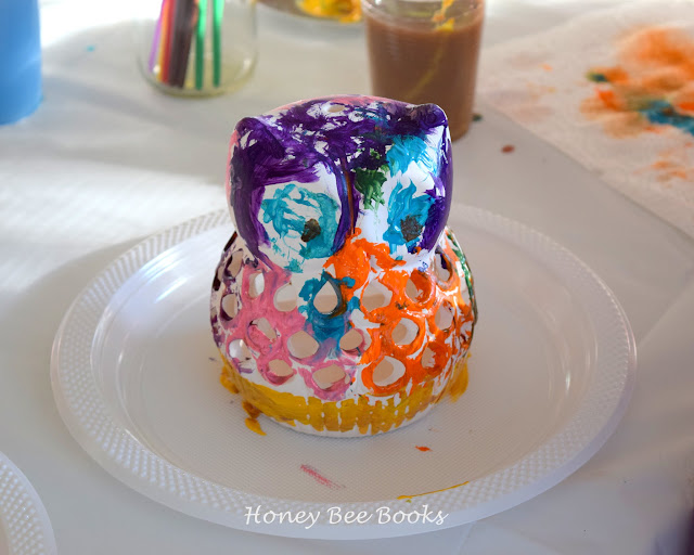 Painting ceramic owl tea light holders made a great activity for an owl themed craft birthday party