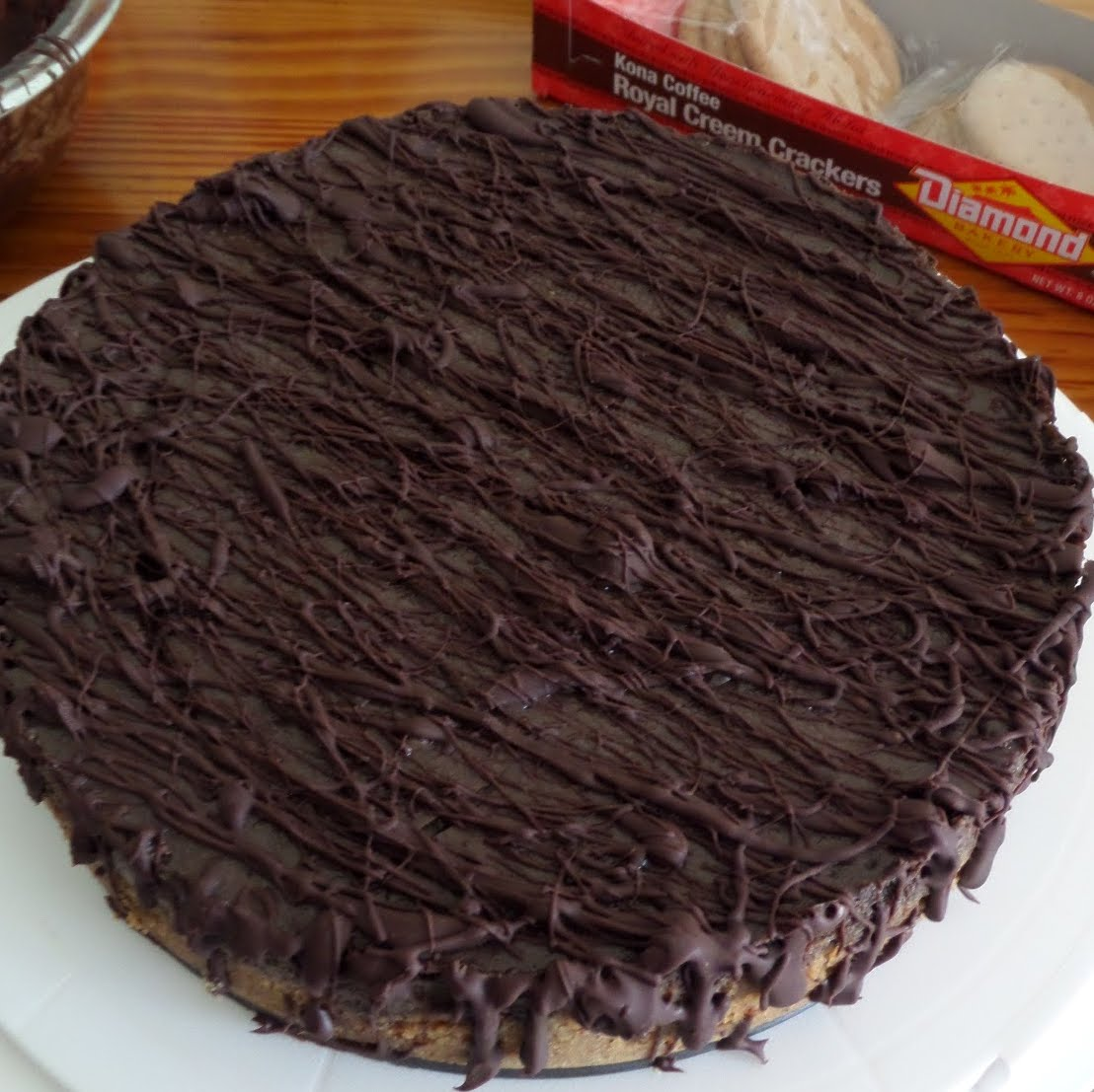 Mocha Chip Cheesecake:  A rich chocolate cheesecake with coffee, mini chocolate chips, and a dark chocolate drizzle.  A perfect birthday cake for my husband.