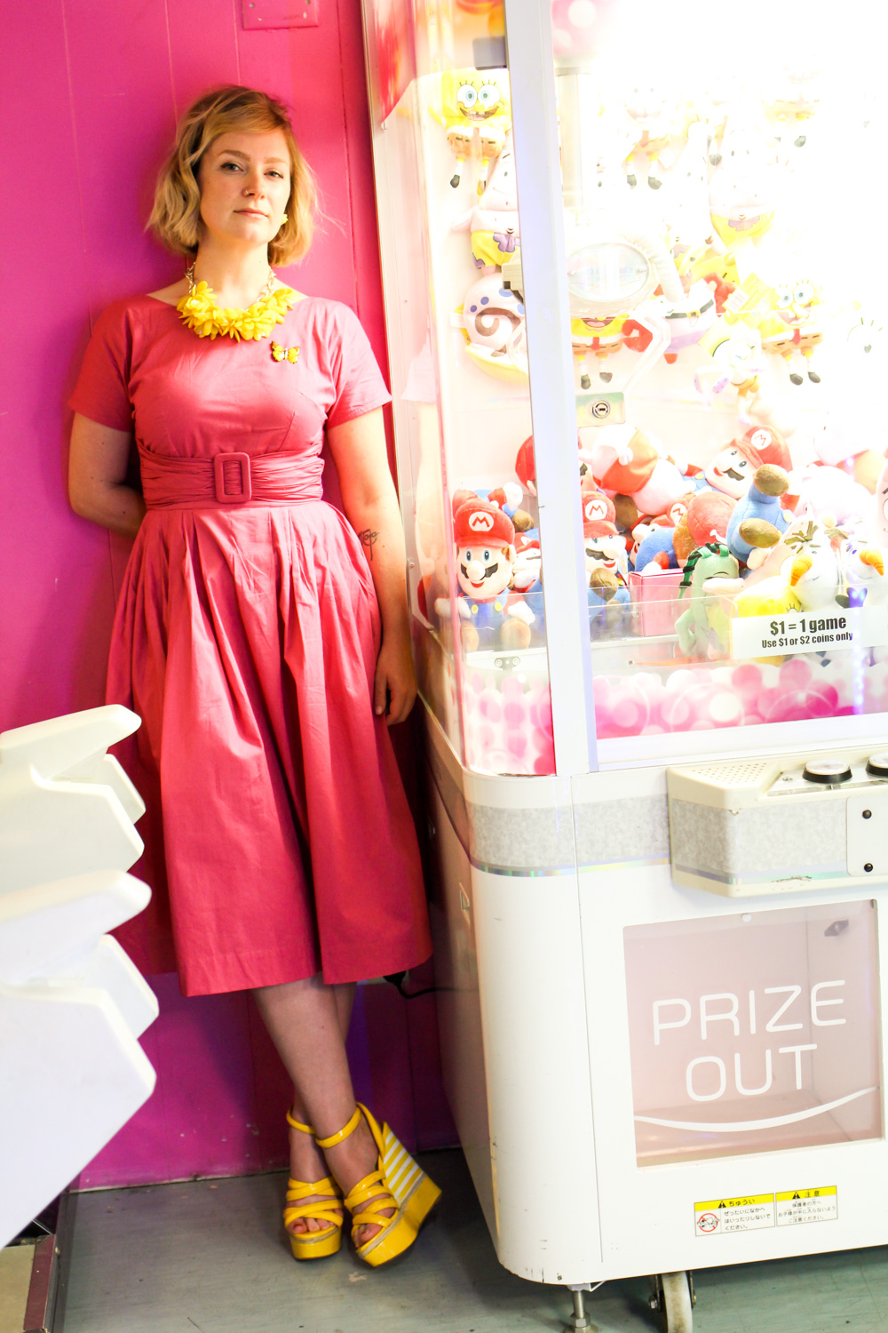 @findingfemme wears pink Lazybones dress to the arcade.