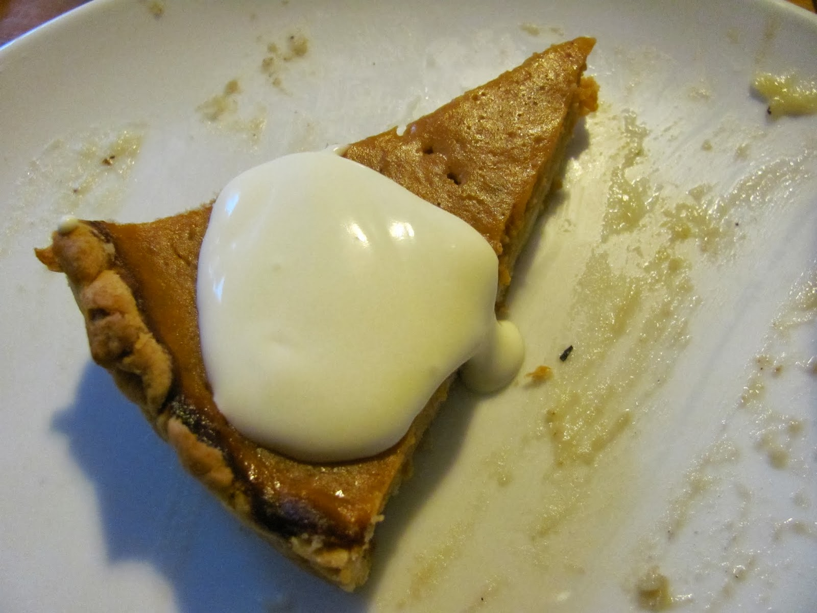 A slice of pumpkin pie with fresh whipped cream in Dublin Ireland Thanksgiving 2013