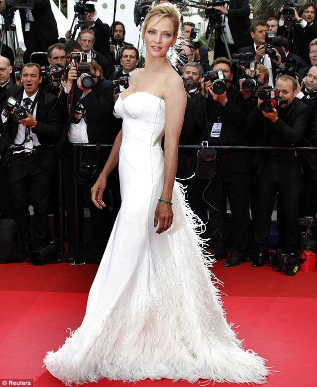 'It's sexy isn't it?': Uma Thurman is in fine feather as she sweeps down the red carpet at Cannes in Versace gown