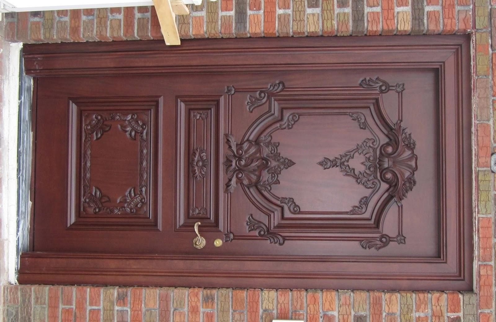 Wooden carving main doors model home interiors