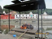 Hindu funeral pyre aside the sacred Bagmati River (Kathmandu, Nepal)