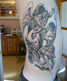 fighting angel tattoo