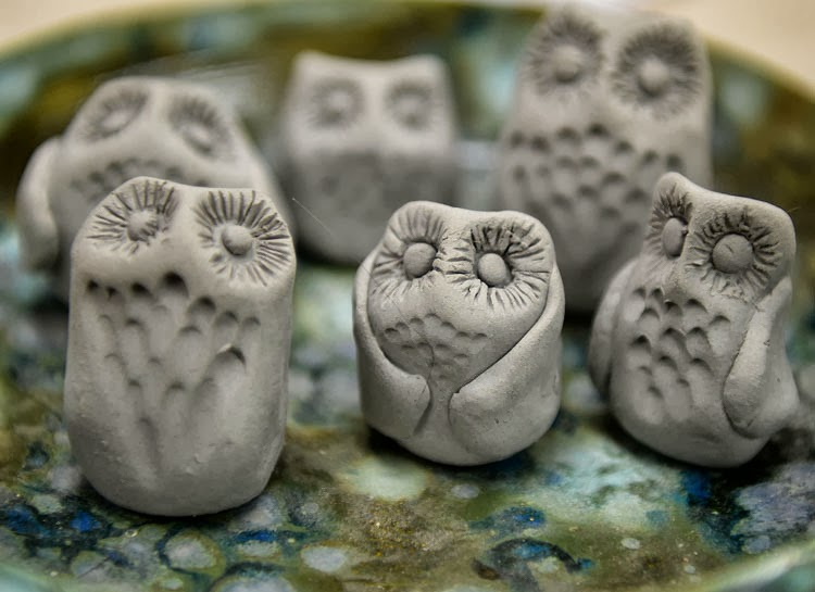 Clay owls waiting to dry and then be fired.