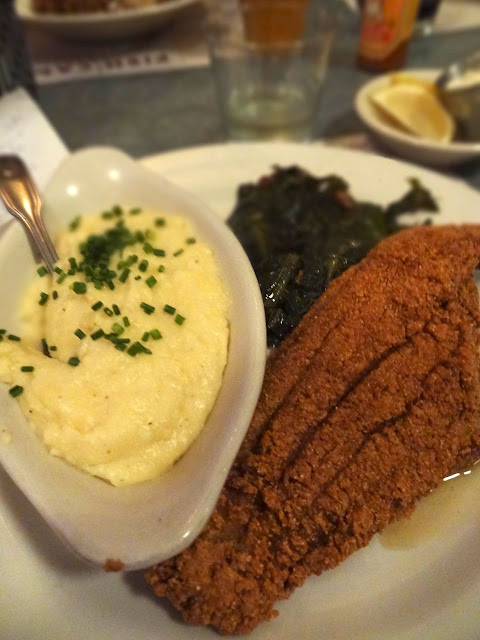 Cornmeal Crusted Catfish with spicy local collard greens, bacon