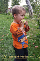 32 month old tastes an apple he holds
