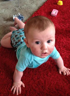 Zach in a close parent pop in cloth nappy