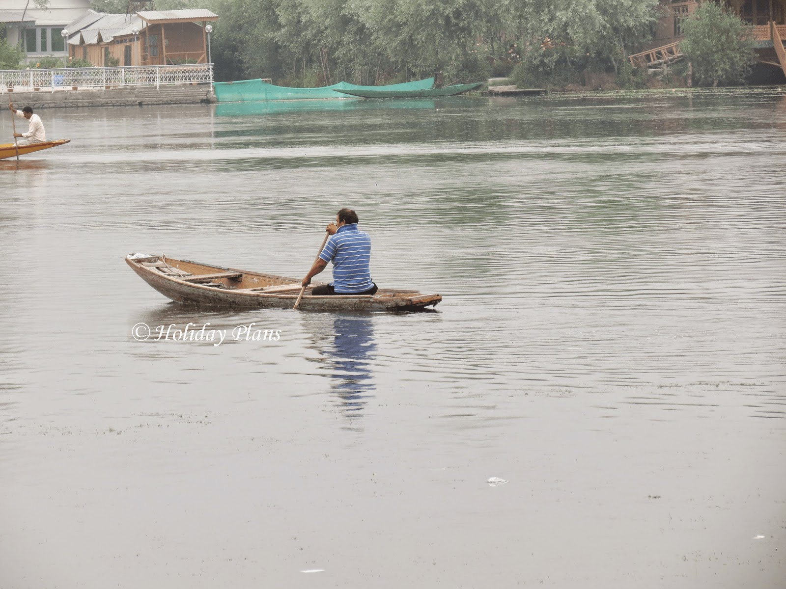 Boatman at Dal Lake