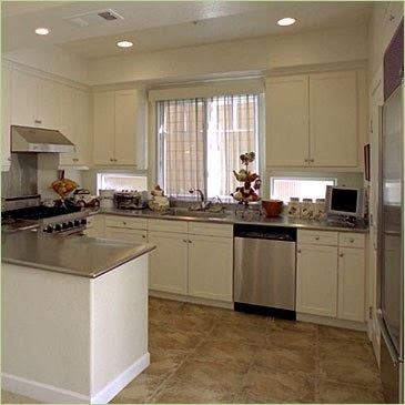 ... stainless steel backsplash and a stainless steel kitchen counter top
