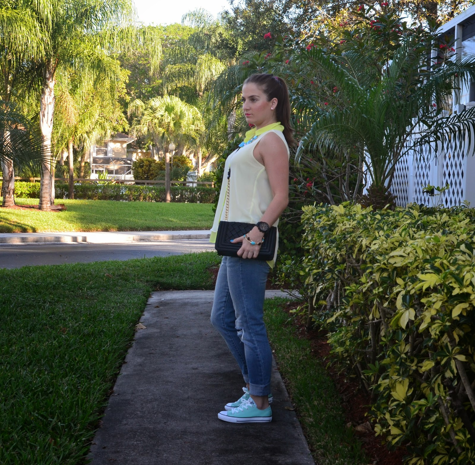 Boyfriend jeans Chuck taylor Neon top Black clutch