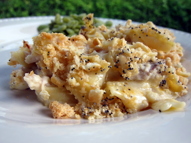 Cheesy Chicken Casserole Recipe - Chicken, noodles, chicken soup, sour cream, cheddar, mozzarella topped with butter crackers and poppy seeds - makes a ton. Great for a potluck. Easy to half or make a whole batch and freeze half for later!