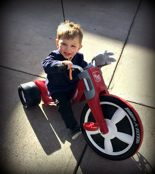 My grandson on his big wheel.