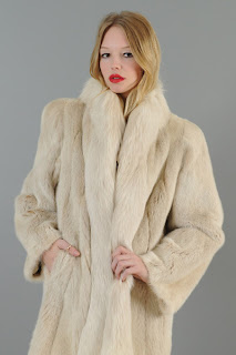 Vintage cream colored 1980's long mink and fox fur coat.