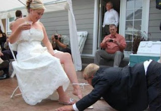 funniest wedding photography: the bridegroom pulls panties of bride