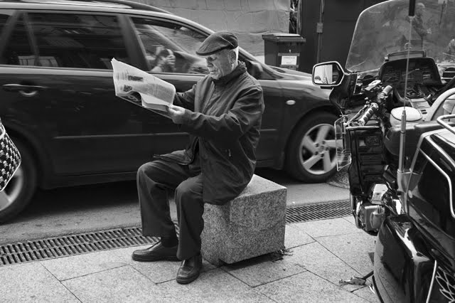 Man Reading Newspapers