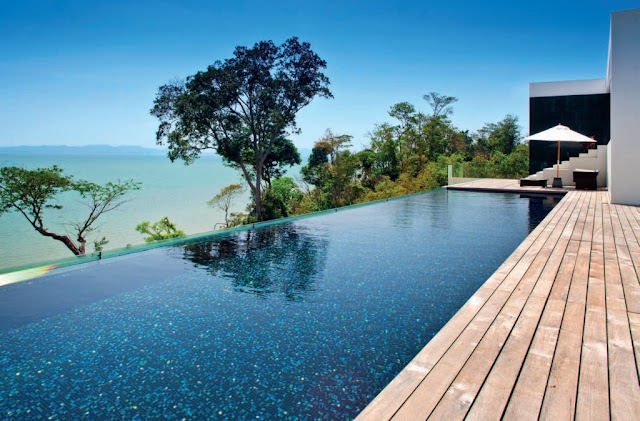 A glittering infinity pool stretches along the upper deck