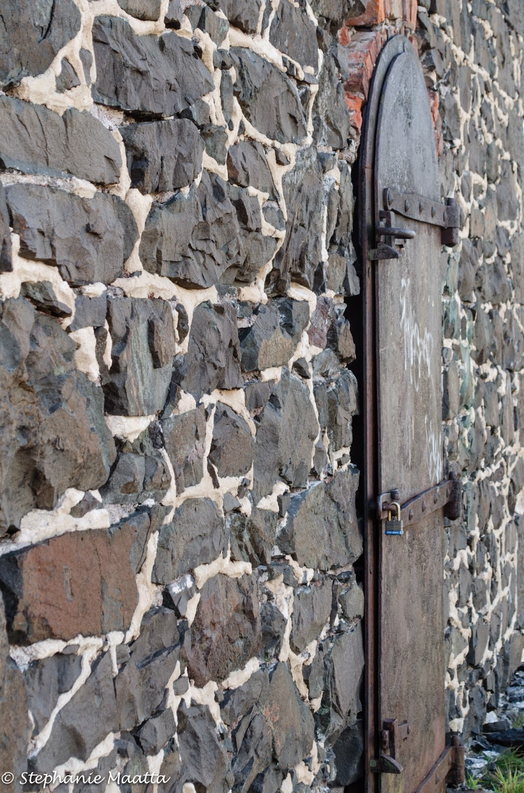 wooden door on a stone wall