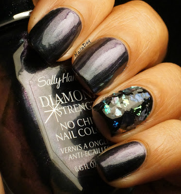 NailaDay: Sally Hansen Black Tie with mylar flakes accent