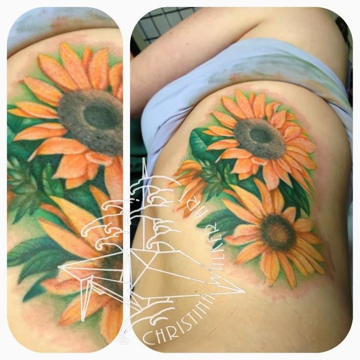 Sunflower tattoo on girl sleeve  on shoulder  on foot  on thighRealistic Sunflower Tattoo On Shoulder