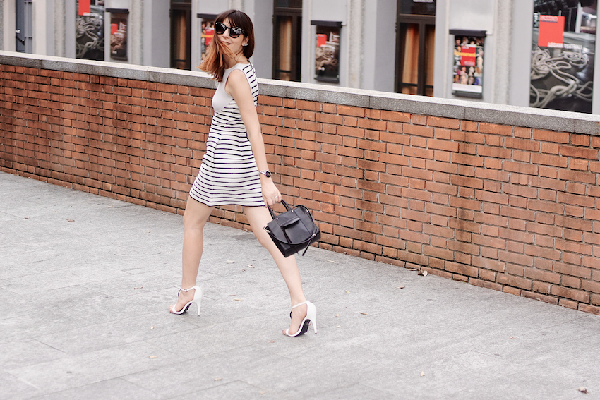 Chic cocktail look featuring a striped raffia dress , white sandals and black accessories. irene buffa street style in Milano