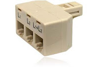 A splitter that takes an RJ14 two-line jack and converts it to two RJ11 one-line jacks