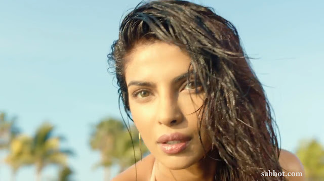 Priyanka Chopra in a sexy golden bikini stills from Exotic feat Pitbull