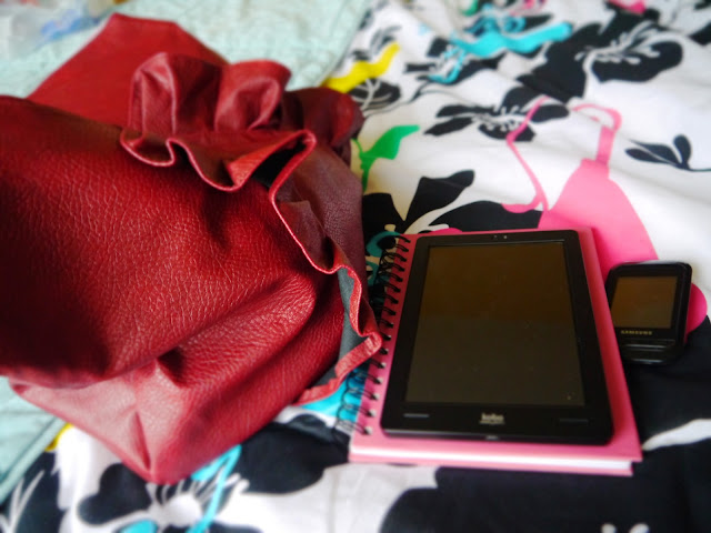 Handbag and notebook ready for work