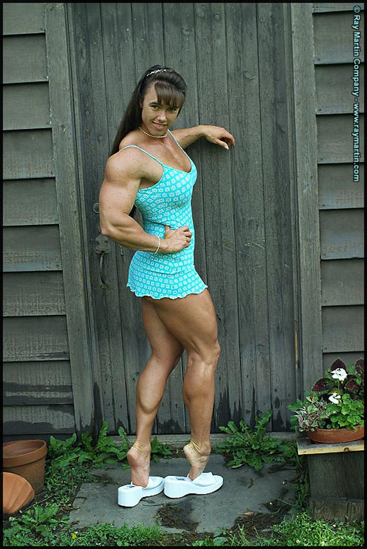 Denise Hoshor Flexing Her Muscular Calves In A Tiny Dress