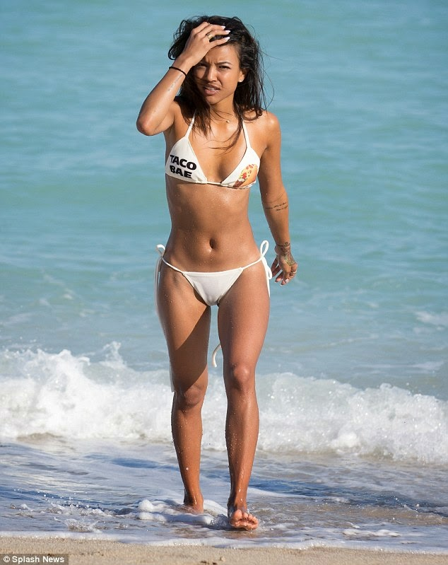 Karrueche Tran hot string white bikini on the beach photo 1