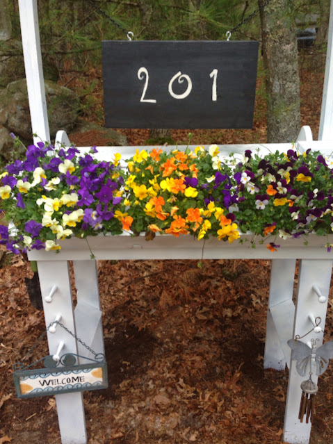 Flower stand house number sign