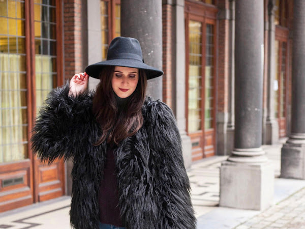 Outfit: shaggy faux fur coat, wide brim hat
