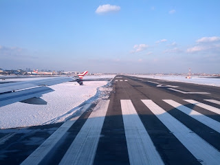 Newark Airport runway 4 bracketed by snow-covered ground.