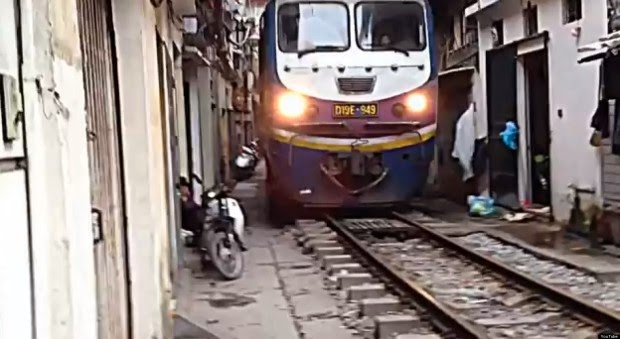 The narrow pedestrian street of Hanoi train passes