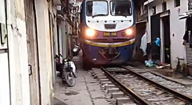 The narrow pedestrian street of Hanoi train passes