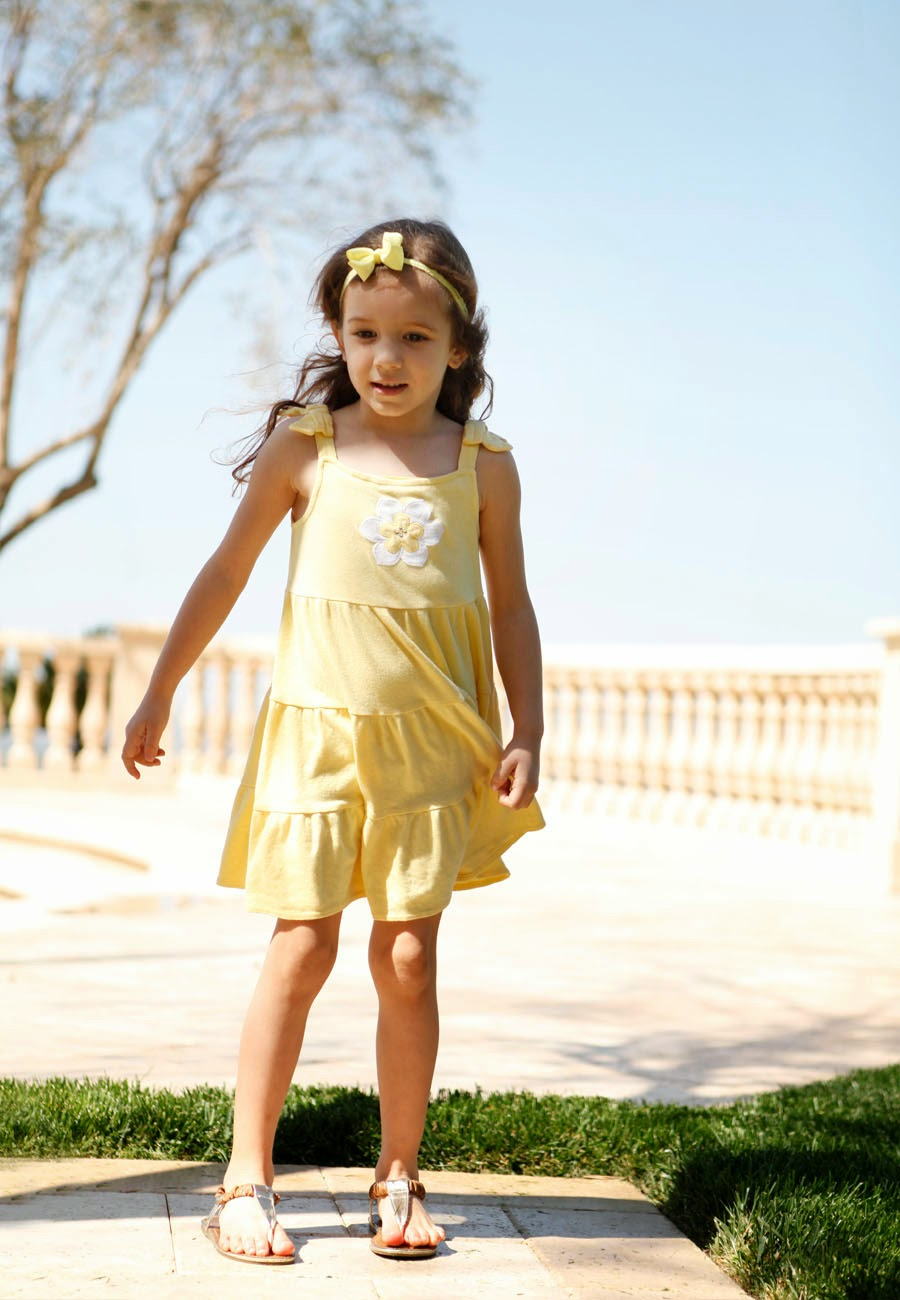 yellow ruffled dress with a white flower